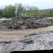 The road goes between two juts of Canadian Shield
