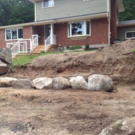 residential landscaping with boulders